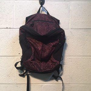 Lululemon plum and black mini backpack 557794
